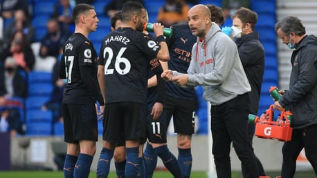 PEP TALK: Guardiola passes on some instructions after the red card.