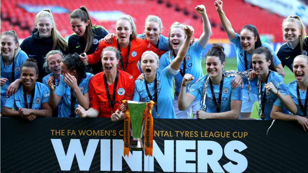 NAME ON THE TROPHY : The City squad celebrate a famous victory