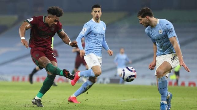 DIAS DEFENCE: Ruben Dias blocks Adama Traore's effort on goal