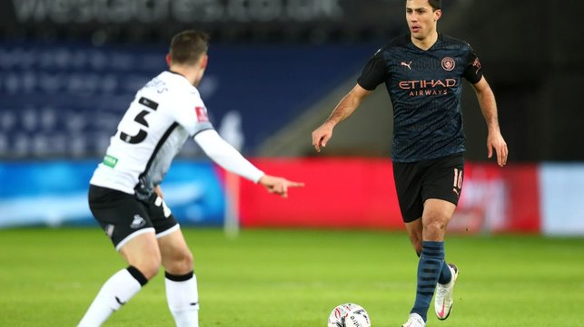ANCHORMAN: Rodrigo brings the ball forward