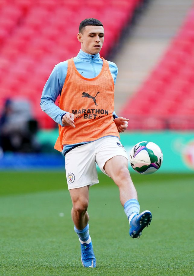GAME FACE : Foden looks fully focused as he gets a feel of the ball pre-match.