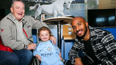 SPECIAL MOMENT: Fabian Delph meets one of brave youngsters at the unveiling of the Royal Manchester Children's Hospital's 3D pain distraction unit