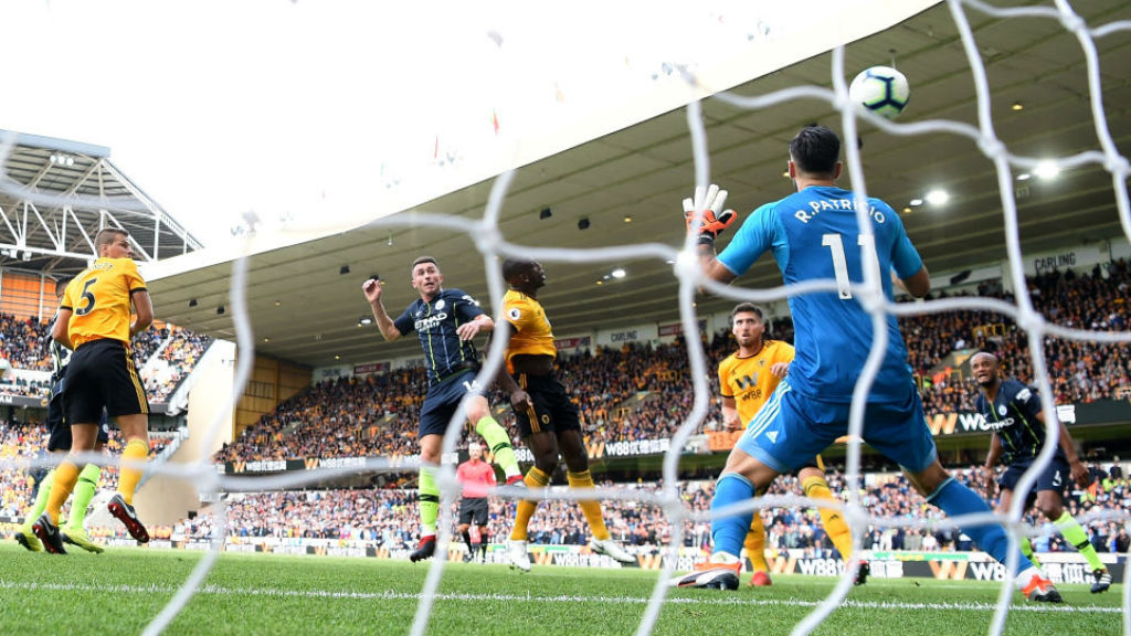 HEAD BOY : Aymeric Laporte beats the Wolves defence to arrow home City's equaliser