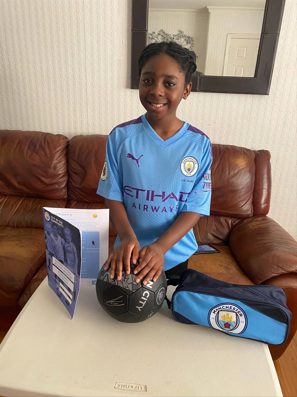 ALL SMILES: The soccer packages were a big hit with the youngsters