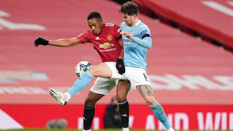 SOLID STONES: John Stones gets the better of Anthony Martial