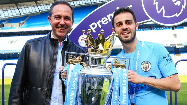 FAMILY AFFAIR : Bernardo and his proud father pose with the Premier League trophy after City's record-breaking 2017/18 title success