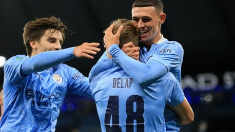 Phil Foden and Adrian Bernabe congratulate Delap