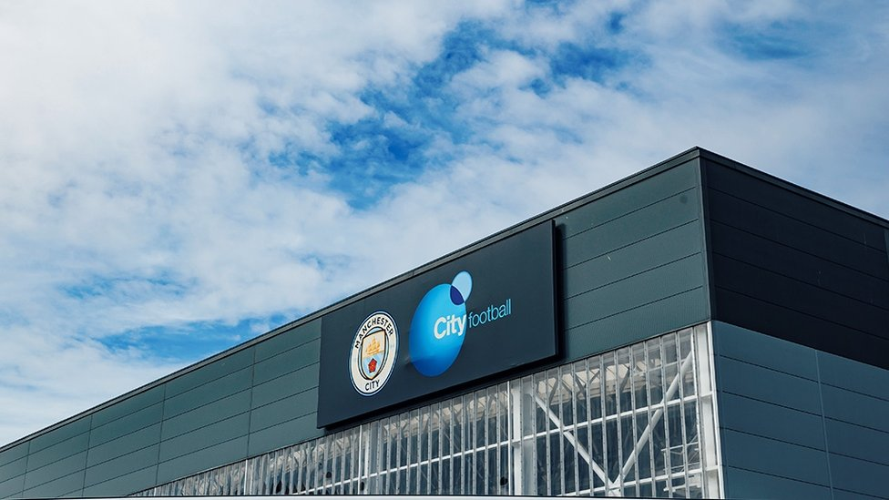 PROUD : Our badge sits proudly at the top of the building.