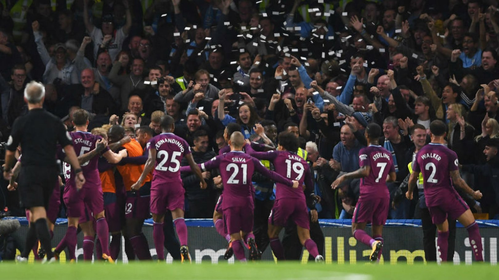 PAPER CHASE: The City players celebrate in front of the travelling fans