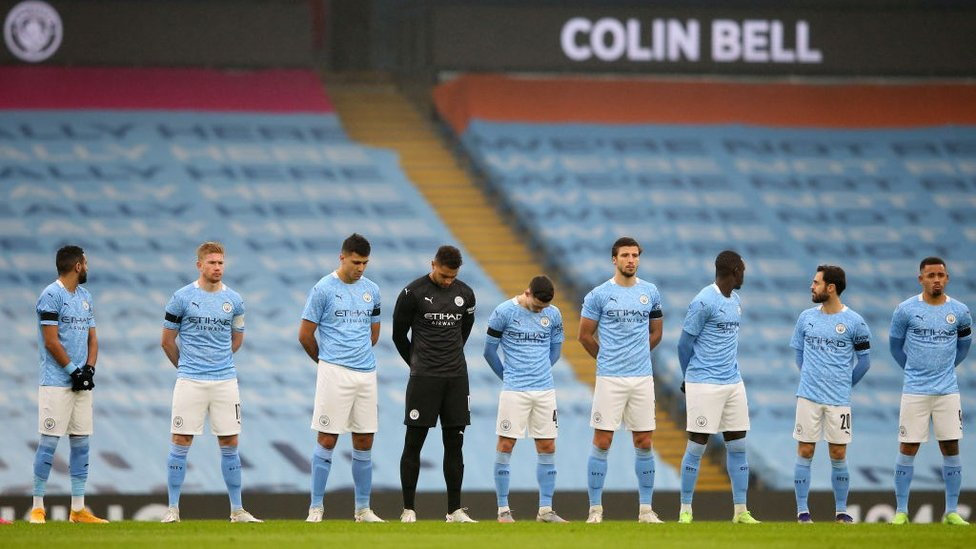 REMEMBERING : An emotional moment as a minute's silence was held for Colin Bell before kick-off.