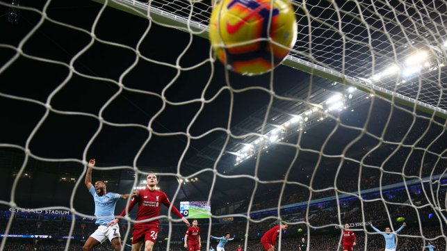 NET GAIN : The ball nestles in the back of the Liverpool goal after Sergio Aguero's wonder goal