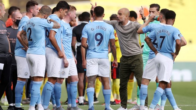 PEP TALK : Guardiola passes on instructions to the players during the first-half water break.