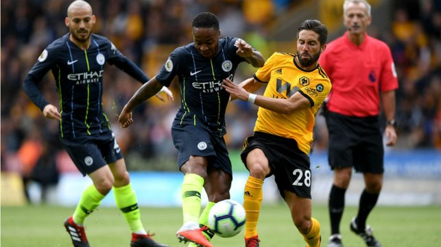 BY THE RIGHT : Raheem Sterling fizzes in a shot on the Wolves goal but is denied by Patricio's wonder save