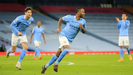 STERLING WORK: Raheem wheels off to celebrate making it 4-0, firing a superb free-kick into the top corner.