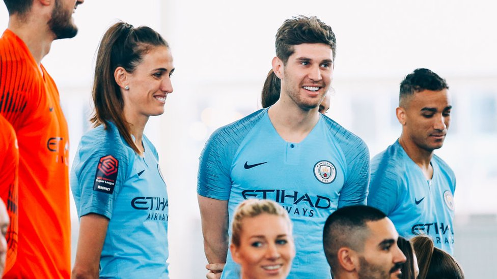 CENTRE STAGE : Jill Scott and John Stones prepare for the photo shoot