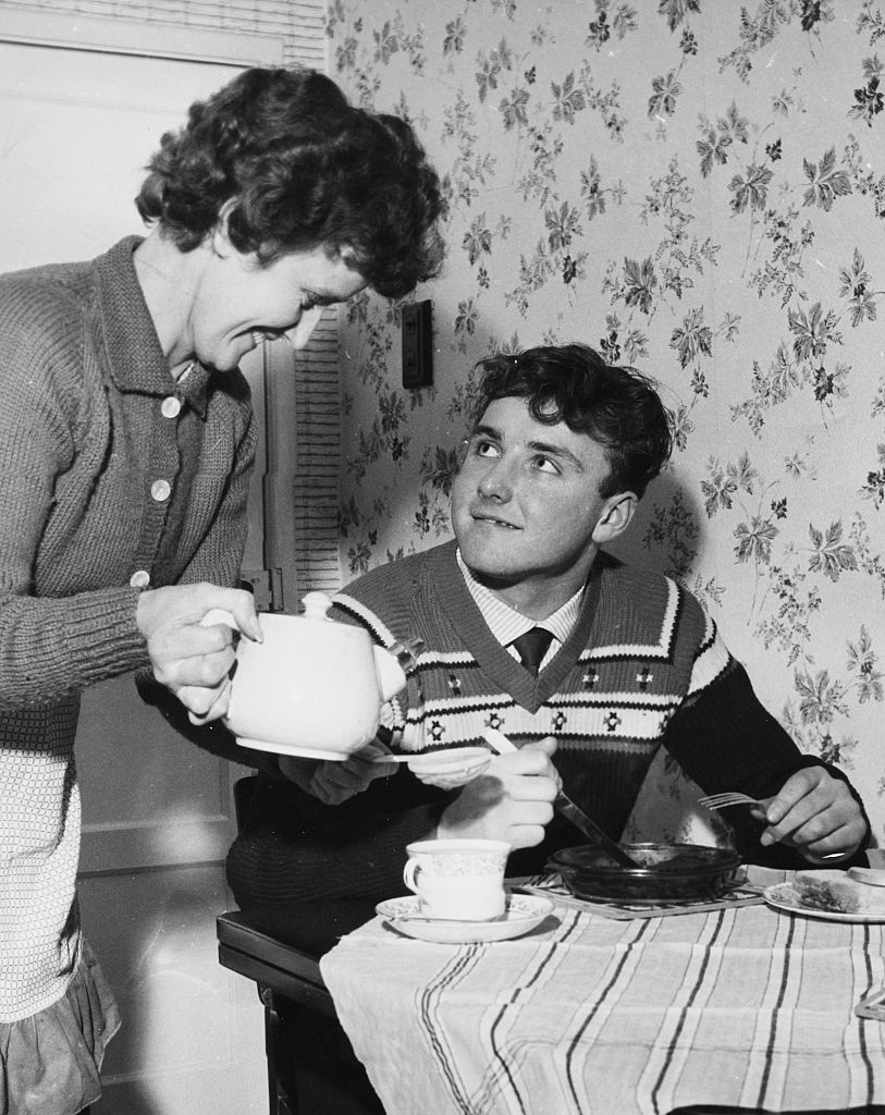MOTHER'S PRIDE: A 15-year-old Glyn Pardoe gets a cup of tea from his Mum the morning after his City debut