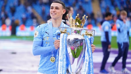 ONE OF OUR OWN: Foden poses with the trophy.