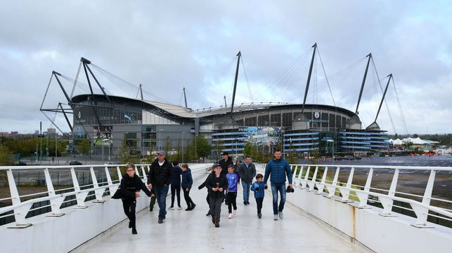CALM BEFORE THE STORM : Dull clouds loom above the Etihad Stadium ahead of kick off