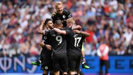 DOUBLE DELIGHT: City celebrate Raheem Sterling's second-half strike.