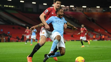 NO ENTRY: Harry Maguire gets a grip on Raheem Sterling