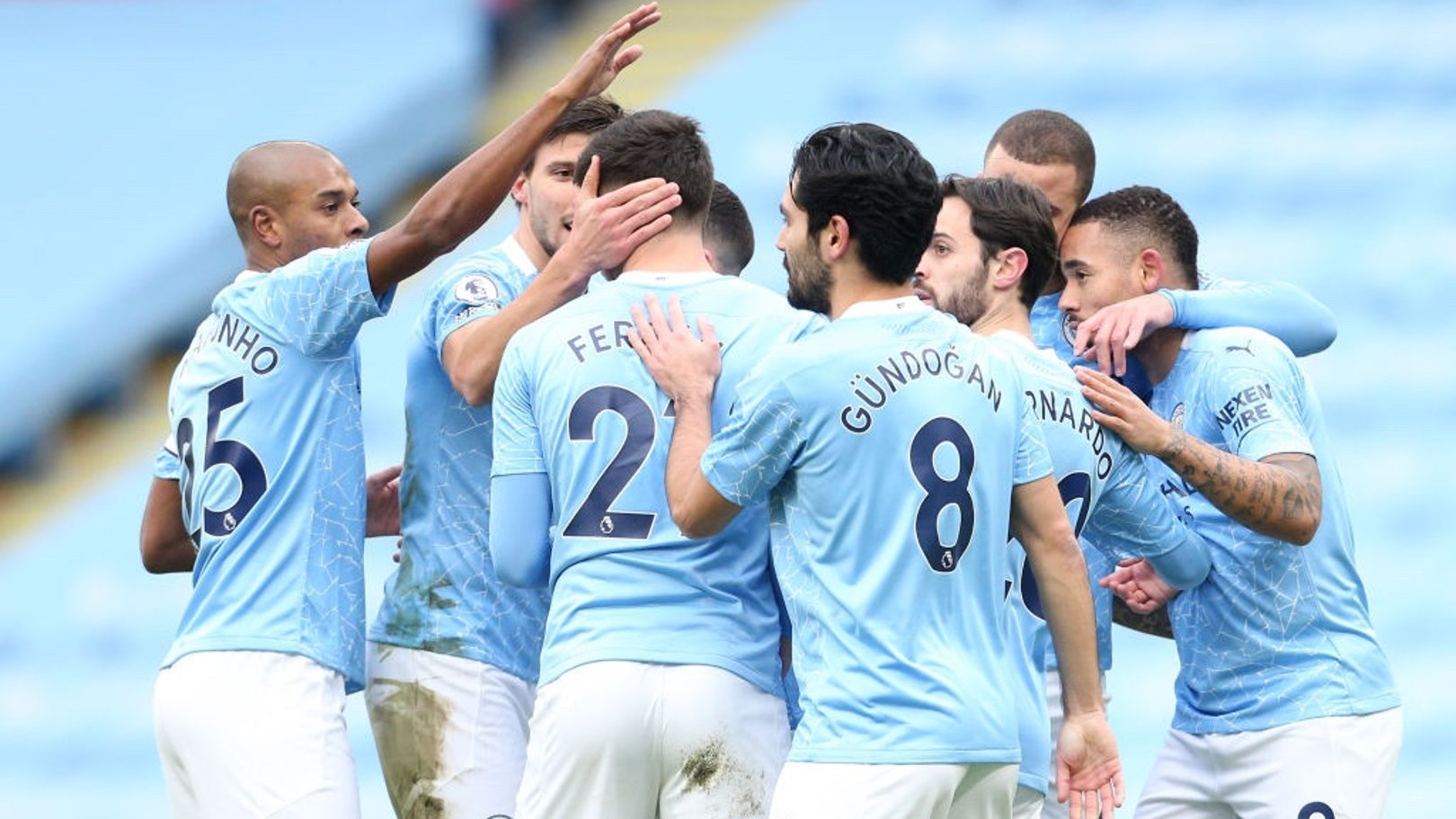 SQUAD GOALS: The team gather to celebrate the opening goal.