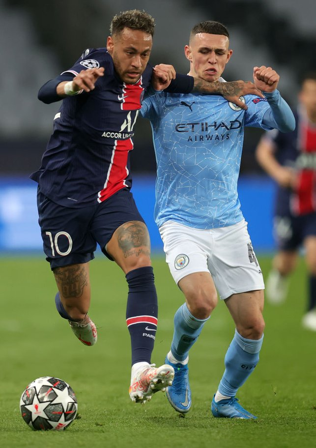 MIDFIELD BATTLE: Phil Foden and Neymar tussle for possession