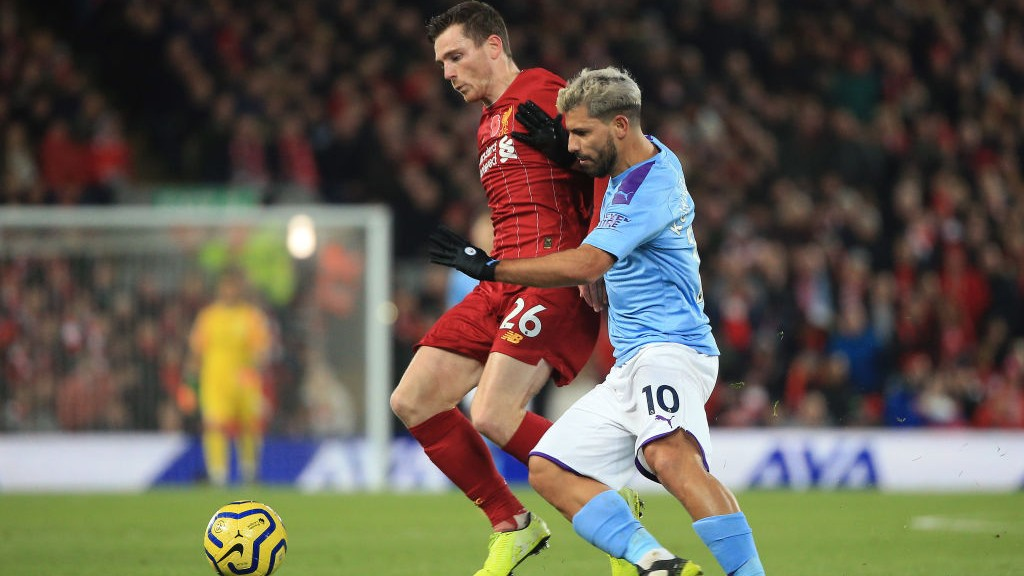 PRESSURE : A battling Sergio Aguero tries to get City back in the game following Mohamed Salah's goal to put the hosts two up.
