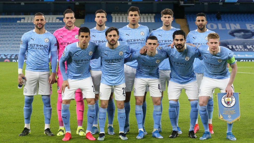 SQUAD GOALS : The starting team pose for a photo ahead of kick-off.