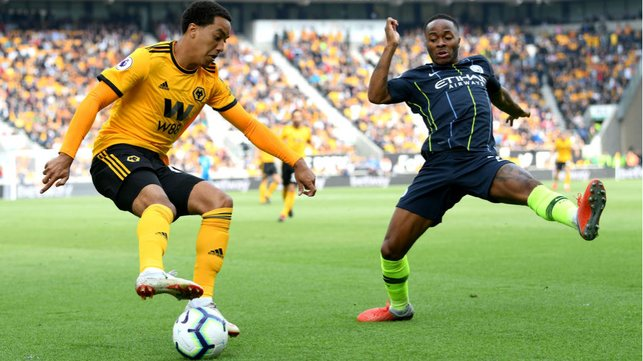 STOP START : Raheem Sterling is at full stretch at he looks to stop Helder Costa