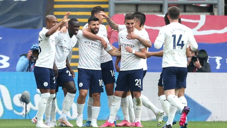 The City team congratulate Sergio Aguero on his super strike