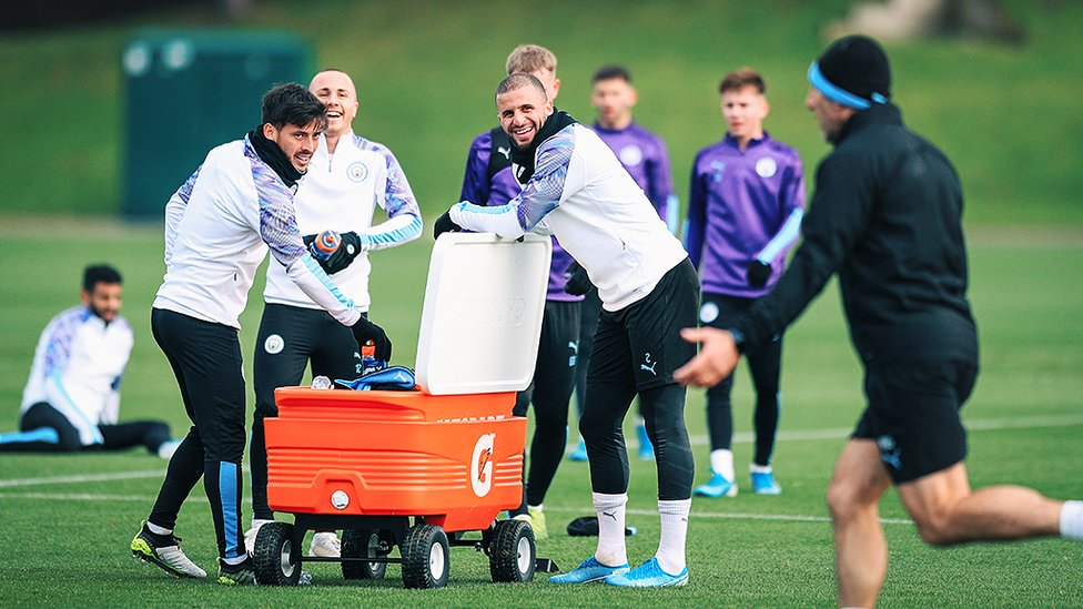 SMILES BETTER : David Silva, Angelino and Kyle Walker take a well deserved breather