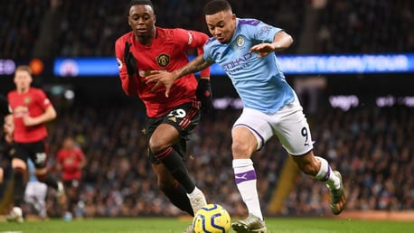 HARD AT IT: Gabriel Jesus tries to free himself of Aaron Wan-Bissaka's attentions.