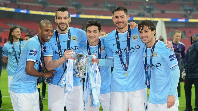 SILVER DREAM MACHINE : Ferna and his City team mates celebrate after our 2014 Carabao Cup final success over Sunderland. It proved to be the first of many trophies in his success-laded City career