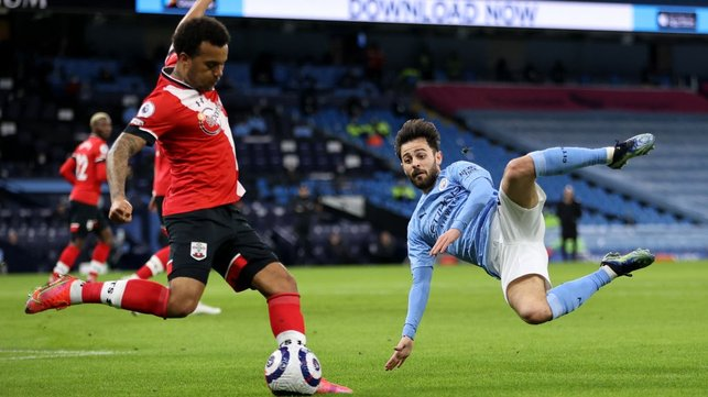 SLIDING SILVA: Bernardo tries to block a clearance from Ryan Bertrand