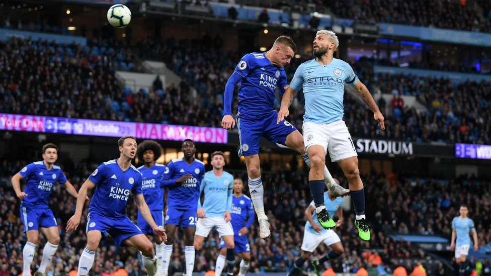 CLOSE : Sergio Aguero sees his header pushed onto the bar by Schmeichel.
