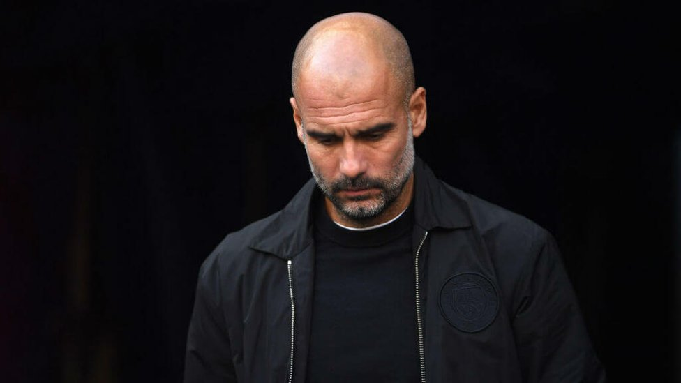 THE BOSS : Pep looks pensive prior to kick off