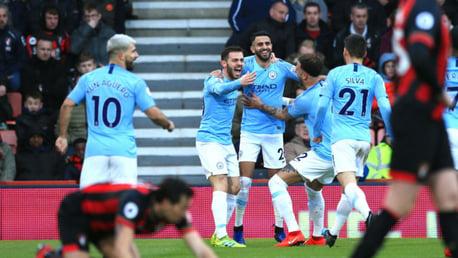 BLUE HEAVEN: Riyad Mahrez celebrates with his City team-mates after his crucial goal