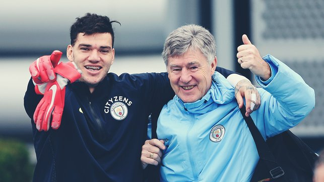 THUMBS UP : Ederson and assistant coach Brian Kidd are all smiles
