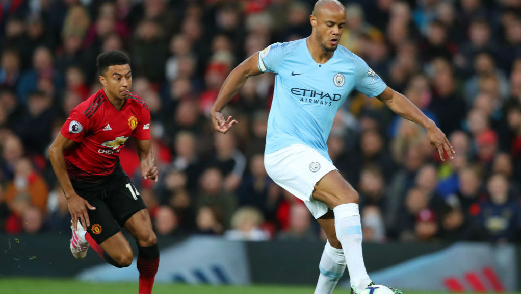 LEADING MAN : Skipper Vincent Kompany gets an early touch on the ball