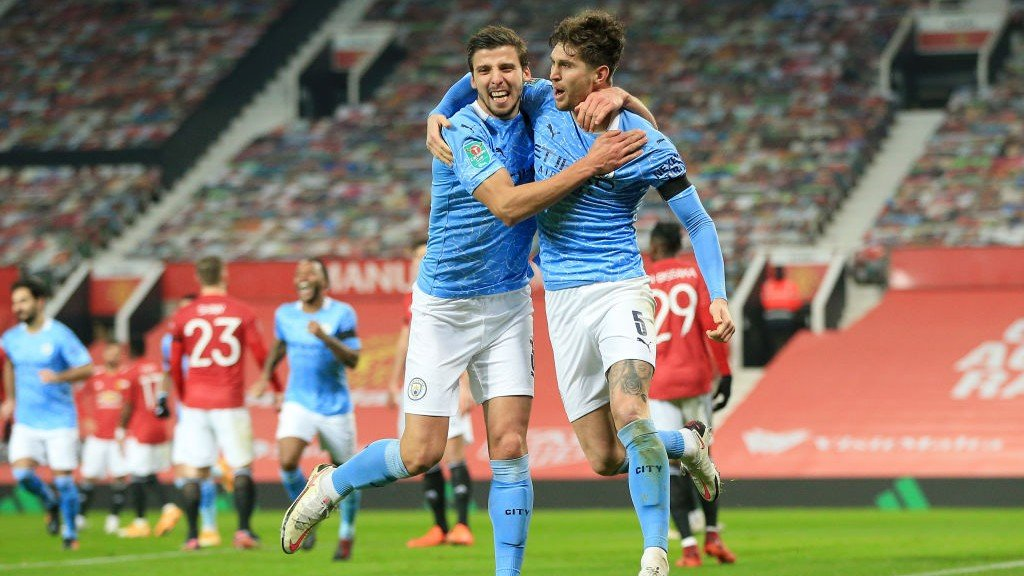 BREAKTHROUGH: John Stones and Ruben Dias celebrate the former's opening goal