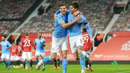 BREAKTHROUGH: John Stones and Ruben Dias celebrate the former's opening goal