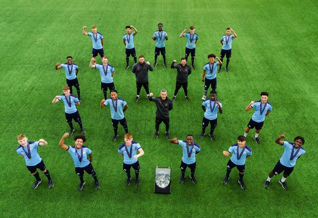 SQUAD GOALS: The City players and coaches celebrate with the Premier League Under-18 North trophy