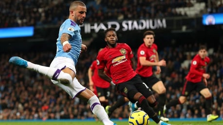 CENTRE: Kyle Walker tries to inspire against Manchester United.