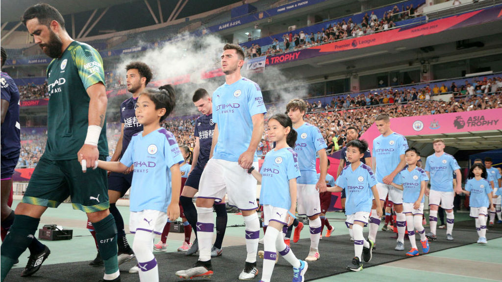 CALL OF DUTY : The City team stride out ahead of kick-off in Nanjing