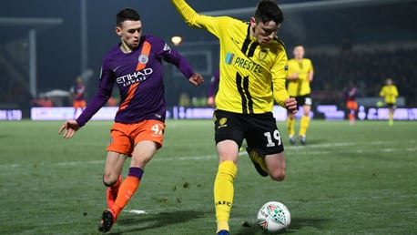 PRESSING HARD: Phil Foden looks to win possession in a dangerous area