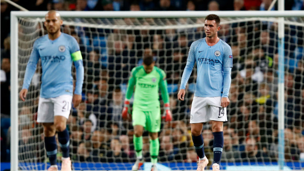 EURO BLOW : The expressions on the City players' faces say it all after Lyon's second goal