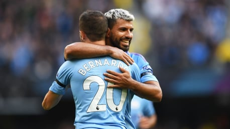 IN SYNC: Bernardo Silva and Sergio Aguero celebrate the former's late strike.
