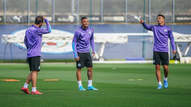 GIFT OF THE GAB : Bernardo Silva and Joao Cancelo share a joke with Gabriel Jesus