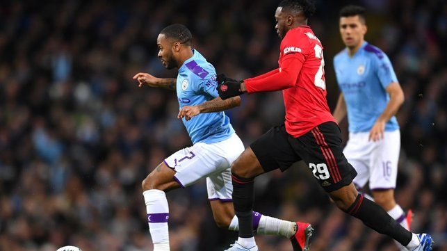 BATTLE : Sterling looks to escape the attention of Wan-Bissaka.