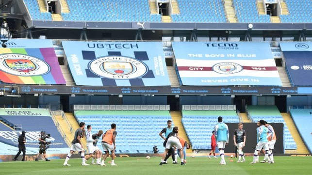 GROUP SESH : The starting team stretch their muscles together as final preparations for the match begin.
